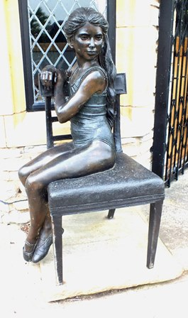 Desmond Fountain (b.1946) A life size partial gilt bronze of a girl with long hair, seated upon a 19th century design chair, 113cm high illustrated