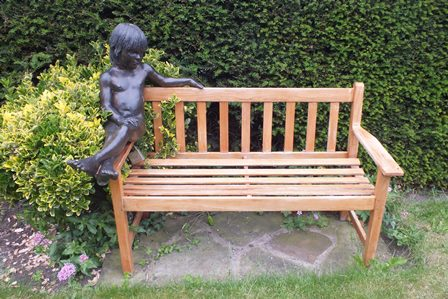 Desmond Fountain (b.1946)  A bronze sculpture entitled  Ashley, a girl seated on the arm of a teak garden bench, her left arm along the back, legs crossed, a limited edition number 9 of 9. 110cm high, 134cm long in total with signed certificate of authenticity dated 1992 illustrated