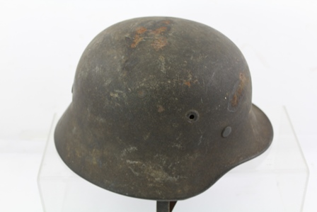 A WORLD WAR II GERMAN STEEL HELMET, small size with leather lining and chin strap