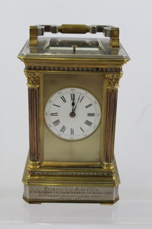 A VICTORIAN GILT AND SILVERED BRASS CARRIAGE CLOCK having Corinthian column case, bi-colour silvered and brass eight day French mechanism with original platform lever escapement and gong strike, faced by an Arabic and Roman enumerated dial, 19.5cm high (with key)