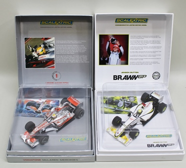 TWO SCALEXTRIC RACING CARS, Lewis Hamiltons McLaren Mercedes with Vodafone livery and Jensen Buttons Brawn GP Virgin and other advertising livery both in original vendors display cases with a Limited Edition Owners Card no.1700/2008 and 2335/5000