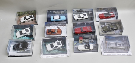 A COLLECTION OF TWELVE JAMES BOND 007 DIE-CAST MODEL VEHICLES each contained in acrylic display case and including Lotus Esprit Turbo from The Spy Who Loved Me & For Your Eyes Only, Aston Martin V8 Vantage from The Living Daylights, Ford Mustang Convertible from Thunderball, Lotus Esprit Turbo from For Your Eyes Only, Ford Mustang Mach 1 from Diamonds Are Forever, Mercury Cougar and Aston Martin DBS from On Her Majestys Secret Service, Aston Martin DB5 from Goldfinger and Toyota 2000GT from You Only Live Twice (12)