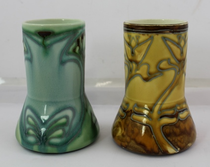 TWO MINTONS SECESSIONIST VASES, one green ground, one yellow ground, both with stylised floral decoration, printed factory marks to base, green one Minton Ltd. No. 2, yellow one Minton Ltd. No. 6, 12.5cm high