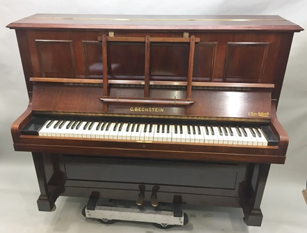 C. BECHSTEIN, BERLIN A MAHOGANY CASED UPRIGHT PIANO, manufactured in 1928, the frame stamped 133849, originally retailed by C. Bruce Miller & Co., Aberdeen