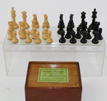 J. JAQUES & SON LIMITED OF LONDON A SET OF BOXWOOD AND EBONY STAUNTON CHESSMEN, in original mahogany box with paper label to sliding lid, the Kings stamped Jaques London, height of King 7cm