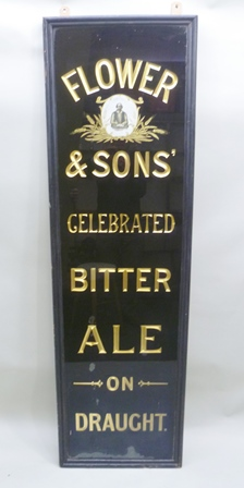 AN EARLY 20TH CENTURY PUBLIC HOUSE SIGN Flower and Sons Celebrated Bitter Ale on Draught featuring a portrait of William Shakespeare (Flowers being a Stratford-upon-Avon Brewery), verre eglomise printed and gilded glass within an ebonised frame, glass panel 188cm x 51cm