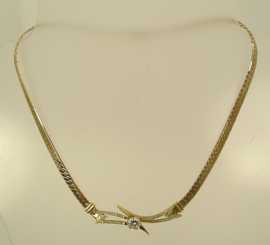 A MODERN DIAMOND PENDANT NECKLET having a central brilliant approximately 'D' colour, good shape, 1.6ct mounted upon a yellow gold 9ct setting, set with multiple 8/8 cut diamonds on an Italian 9ct gold chain
