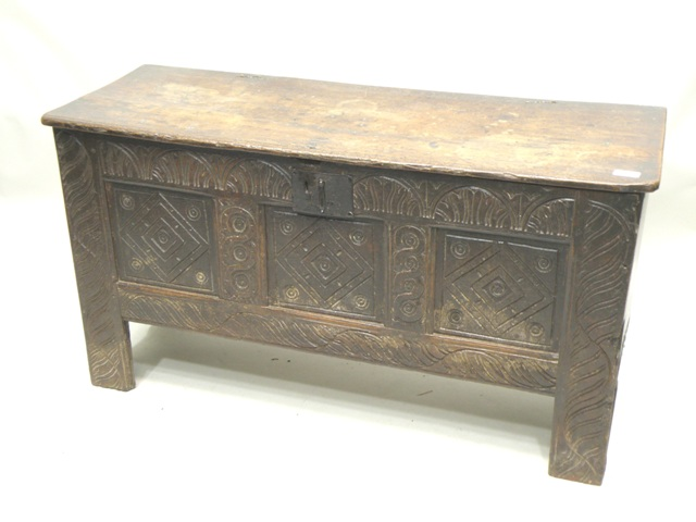 A PART 18TH/19TH CENTURY OAK SWORD CHEST/COFFER having later plank top, carved front, remnants of candle box, on bracket feet, 60 x 110cm