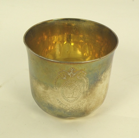 POSSIBLY JOHN RICH  A GEORGE III SILVER TUMBLER CUP having caulked rim, mercurial gilded interior and a Regency cartouche, London 1783, 67mm high x 75mm diameter, 109g