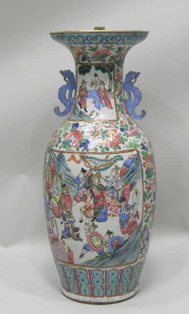 AN EARLY 20TH CENTURY CHINESE CANTON EXPORT PORCELAIN VASE having flared neck, twin handles, all over decorated in the polychrome palette with vignettes of ennobled ladies and gentlemen, 61cm high