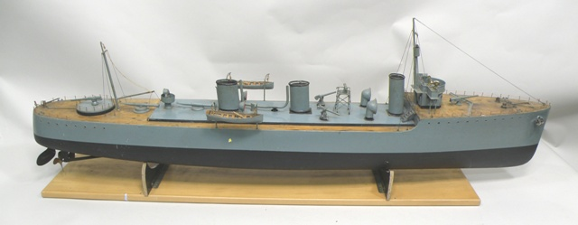 A 1920's LIVE STEAM PROPELLED MODEL OF HMS RIFLEMAN MOTOR TORPEDO DESTROYER. A Great War period Acorn class vessel in grey camouflage livery. Prow to stern 1.4m long, with steam boiler confirmed circa 1908 by Stuart Turner engineers (sold with a gastank test certificate, un-dated and not verified paperwork available at viewing)