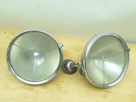 A PAIR OF JOSEPH LUCAS P100 PATENT CHROME PLATED HEAD LAMPS