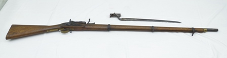 A 19TH CENTURY SNIDER-ENFIELD RIFLE breech loading, 39 barrel with three bands, Tower c.1870 mark and stamped Snider patent with socket bayonet.