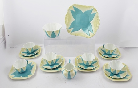 A QUANTITY OF SHELLEY CHINA TEA WARE the Dainty pattern no.272101 registered in 1896, lobed form coloured blue and tinged with yellow, comprising milk jug, sugar bowl, six tea plates, serving plate, six cups and five saucers