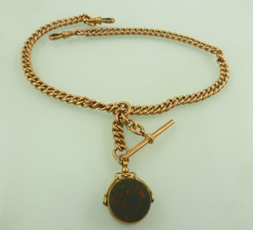 A 9CT GOLD CURB LINK DOUBLE ALBERT with T-bar and two dog clips and an obsidian/cornelian swivel seal