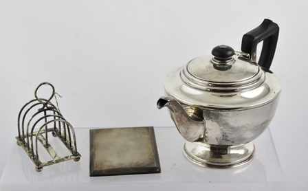 WILLIAM HUTTON & SONS LTD A late Victorian silver toast rack, London 1898, raised on ball feet together with a silver teapot and a silver cigarette case