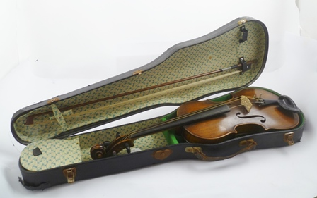 A LATE 19TH CENTURY VIOLIN, bears internal printed paper label Manufactured in Berlin - copy of Joseph Guarnerius, together with bow, cased
