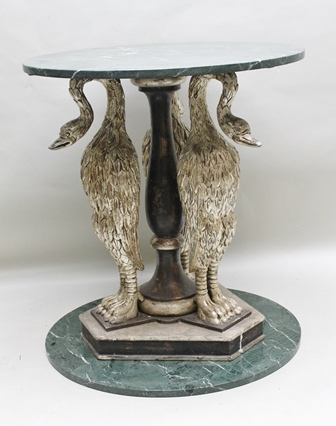 A PAIR OF 19TH CENTURY EMPIRE DESIGN CENTRE TABLES, each of the stems comprising three silvered, carved wood Crane style birds with substantial carved feet, acting as caryatids about a central baluster stem, raised on triangular base, each with green marble top, 76cm diameter