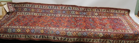 A LAST QUARTER 19TH CENTURY WOVEN WOOL KURDISH LONG RUG with standard geometric pattern and triple guard border, 275cm x 110cm (sold with original Samarkand Galleries certificate)