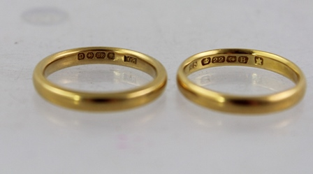TWO 22CT GOLD PLAIN BARREL PATTERN WEDDING BANDS, sizes M & M tight