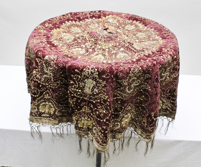 A 19TH CENTURY RAJASTHANI ROYAL PURPLE PARASOL with embroidered wire and sequin decoration, having peacocks to the deeply fringed edge