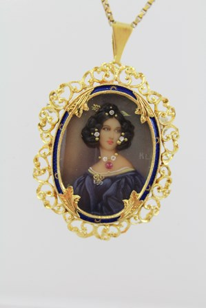 A VICTORIAN STYLE GOLD COLOURED METAL BROOCH PENDANT, a miniature of a dark haired girl, studded with diamonds and rubies, on a box link gold coloured metal chain, 40cm long