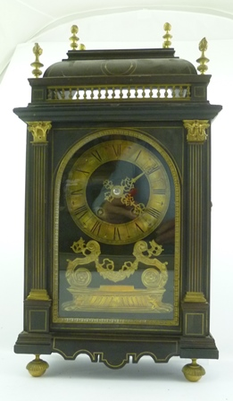 A 19TH CENTURY FRENCH BRACKET CLOCK, the movement back plate stamped Pinchon Fils Aine, Paris, the ebonised brass inlaid and mounted case with caddy top, columns flank the arched door revealing brass chapter ring bearing Roman numerals, fitted eight day chiming movement, raised on fluted cap brass feet. (The inside of the back door bears a printed paper label, From James A. Butti, Fine Art Collector and dealer in Articles of Virtu, 7 Queen Street, Edinburgh. The clock complete with monopod wall bracket, the gilt scroll decoration with armorial shield flanked by animal supporters, clock 30cm wide x 54cm high