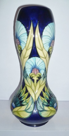 A MOORCROFT VASE, Windsor Carnation pattern, limited edition 203/300, of gourd shape, having tube lined and painted decoration, designed by Sally Tuffin, impressed and painted factory marks to base, 28.5cm high