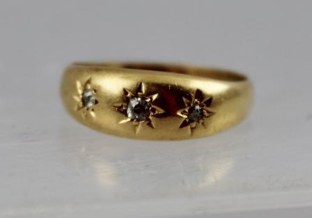 AN EDWARDIAN 18CT GOLD SET DIAMOND THREE-STONE GYPSY SET DRESS RING, Chester 1902, size R 1/2, 5g. gross