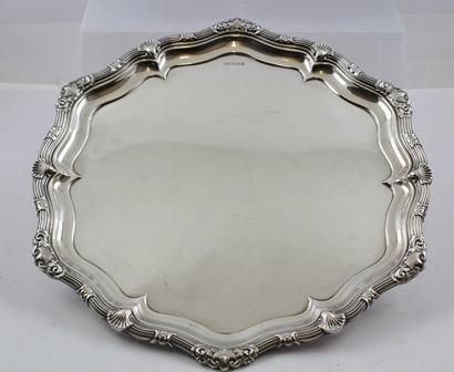 WALKER & HALL A SILVER DRINKS TRAY having heavy cast scallop and fancy scroll border, un-engraved centre, Sheffield 1937, 37cm diameter, 1483g