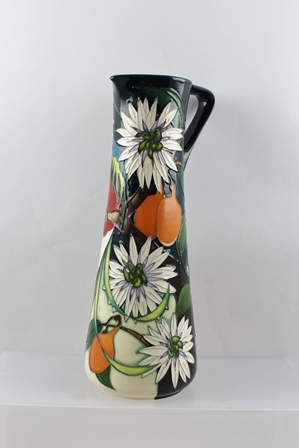 A MOORCROFT CERAMIC JUG, designed by Vicky Lovatt, tube lined and hand painted in the Resplendent Quetzal pattern from The Costa Rica Collection, a limited edition no. 21/50, hand painted and impressed factory marks to base, 31cm high