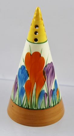 A 1930s CLARICE CLIFF CONICAL SUGAR SIFTER, hand painted in the Autumn Crocus design, printed back stamp, Bizarre signature to base, cork stopper (we would consider the stopper to be original), 14cm high