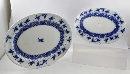 A 19TH CENTURY MINTONS OVAL MEAT DISH WITH MAZARIN, blue cranes in flight decoration by Dr. Christopher Dresser, 44cm