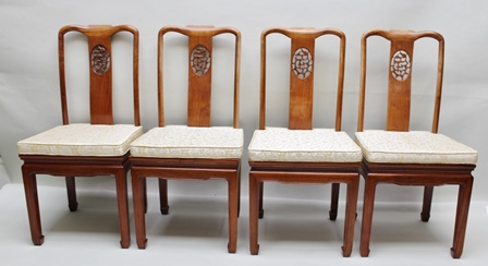 A WELL MADE 20TH CENTURY CHINESE HARDWOOD DINING SUITE, the extending table closes to a circle, 114cm diameter, with blind carved scrolling decoration to the frieze, on squared supports, fitted two leaves, 51cm wide, together with the MATCHING SET OF EIGHT DINING CHAIRS, comprising six singles and a pair of open arm carvers, with pierced decoration to the back splats