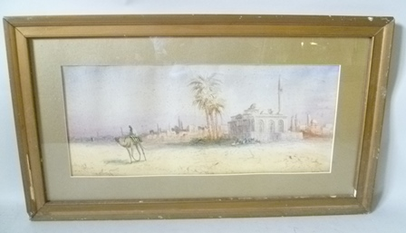 ANTON PERUGINI City on the edge of the desert, featuring a Mosque, and a figure riding a camel, a Watercolour circa 1910, signed, 22cm x 52cm in gilt glazed frame