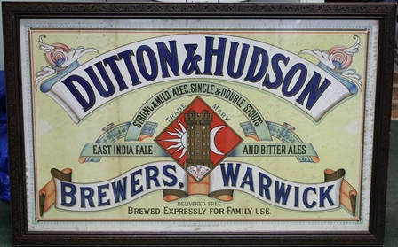 AN ORIGINAL LATE 19TH CENTURY BREWERY ADVERTISING LITHOGRAPH by Sir Joseph Causton & Sons, London, for Dutton & Hudson of Warwick, 82cm x 101cm in carved wood effect glazed frame