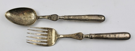 WILLIAM ELEY & WILLIAM FEARN A PAIR OF GEORGE III SILVER SERVERS, comprising fork and spoon, engraved crowned lion crest, holding aloft in one paw a fleur de lys, London 1800, (loaded silver handles)