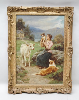 BASIL BRADLEY, RWS Introducing the Puppy a mountain and lake landscape, a young woman in the foreground holds up her puppy, a dog and calf look on, Oil painting on canvas, signed, 60cm x 40cm, in ornate gilt frame
