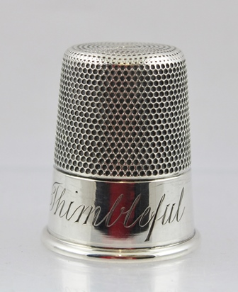 CHARLES HORNER A SILVER THIMBLE TODDY TUMBLER CUP having rolled rim and engraved Just a thimbleful, Chester 1906, 35g, 5cm high