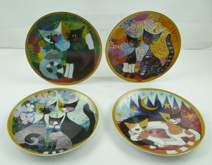A COLLECTION OF GOEBEL ROSINA WACHMEISTER STYLIZED PORCELAIN CATS painted and gilded decoration, nine in original tins, three in original card boxes, together with a house design display stand and four collectors plates with cat designs after Rosina, 20cm diameter
