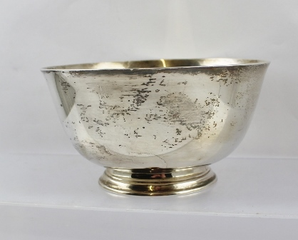 SHREVE CRUMP LOW & CO AN AMERICAN SILVER COLOURED METAL BOWL being a reproduction after Paul Revere, with flared lip and spun foot, monogrammed D.A. & J., 8cm high x 15.5cm diameter, stamped Sterling 308g