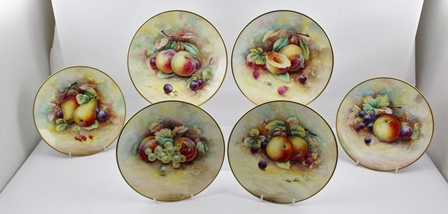 A SET OF SIX MINTON HAND PAINTED CABINET PLATES decorated with various fruits against a mossy background, each signed A Holland, painted and embossed factory marks to base, 23cm diameter