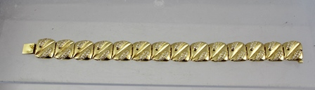 A DIAMOND MOUNTED GOLD COLOURED METAL FLEXIBLE PLAQUE  BRACELET comprising 14 grooved rectangular links, each set 20 diamonds and snap clasp, 19cm long, stamped 14k (gross weight 48g, approx 5cts)