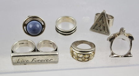 A SELECTION OF TEN SILVER AND SILVER COLOURED METAL RINGS including a two finger Live Forever, another cast with a bird etc.