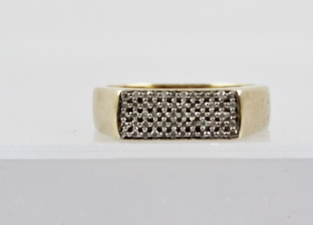 A 9CT GOLD UNISEX DIAMOND FINGER RING having a rectangular head set with 60 small diamonds, on a polished shank, Birmingham 2007, size T