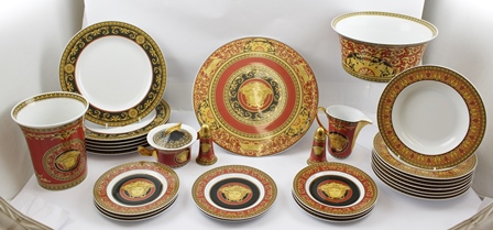 A QUANTITY OF VERSACE MEDUSA PATTERN TABLE CERAMICS includes set of six dinner plates, 27cm diameter, eight dessert bowls, 22.5cm diameter, eight dessert plates, 18cm diameter, a tazza, a large serving bowl, a flared vase, 18cm high, covered sugar bowl, milk jug and pair of condiments