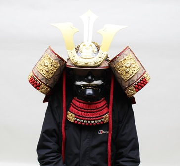 A LATE 20TH CENTURY KABUTO JAPANESE SAMURAI HELMET with mask, guard richly decorated, with paperwork, in a black lacquer storage box, 57cm wide