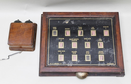R.E. & C. MARSHALL LTD. CHELTENHAM A LATE VICTORIAN/EDWARDIAN SERVANTS BELL INDICATOR, the bespoke mahogany framed indicator panel with verre eglomise key - i.e. Boudoir, Major Warners Bedroom, Smoke Room, Gun Room etc., panel 40cm x 50cmand another DOUBLE BELL BOX