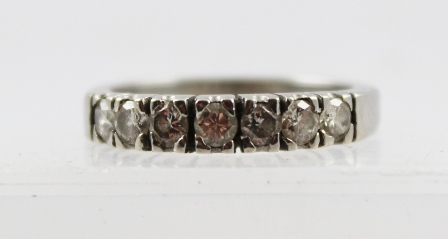 AN 18CT WHITE GOLD RING set with seven diamonds