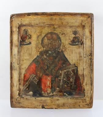 19TH CENTURY RUSSIAN SCHOOL AN ICON half length of The Christ Pantocrator holding the Holy Book, 27cm x 23cm